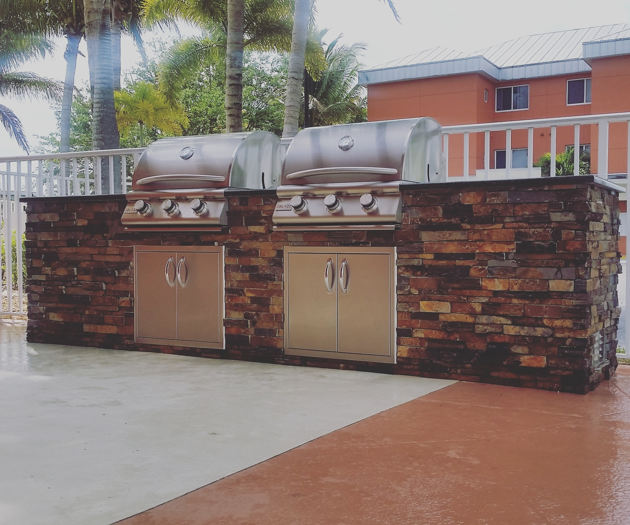Dueling grills custom outdoor kitchen build elegant for Building outdoor kitchen cabinets