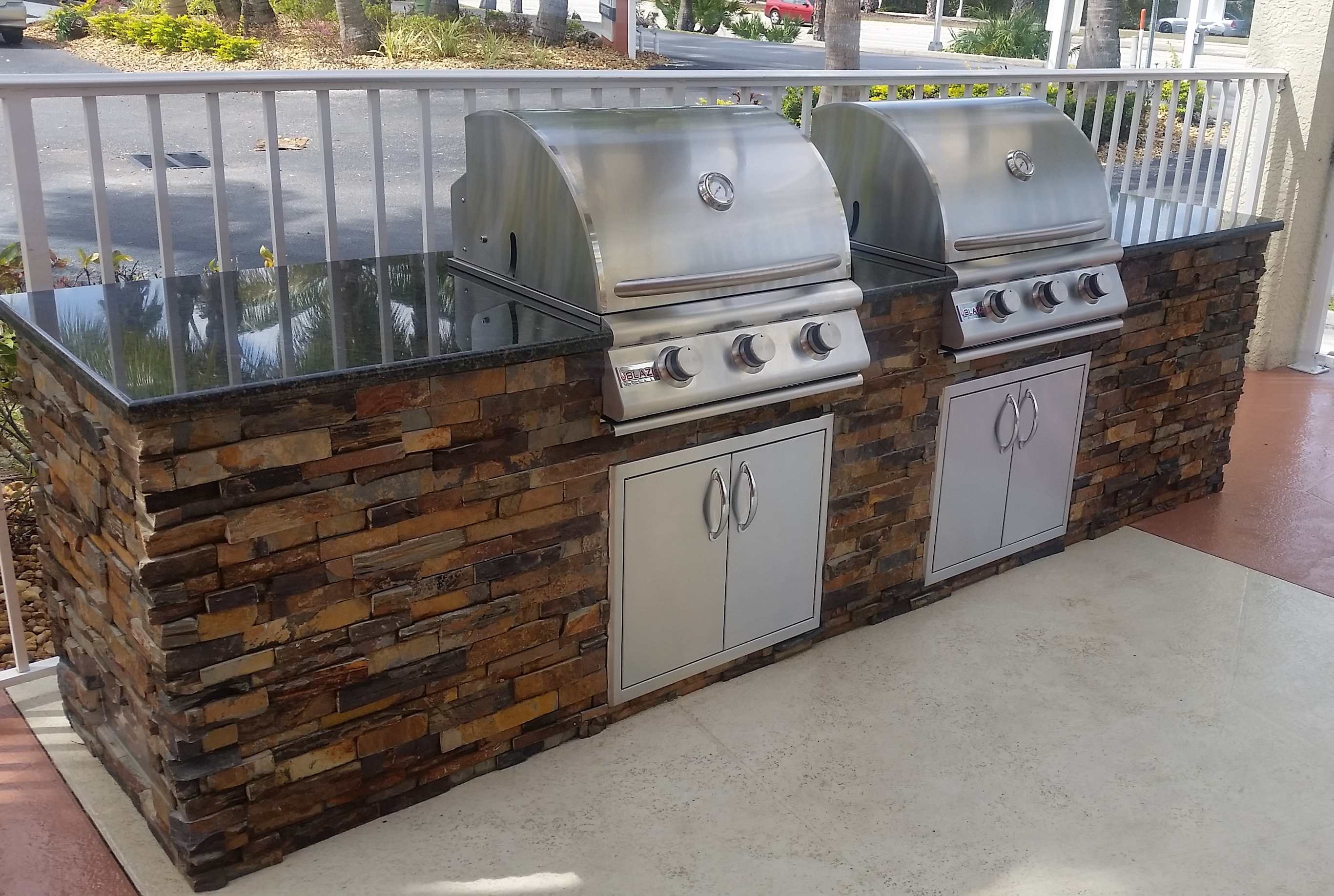 Dueling grills custom outdoor kitchen build elegant for Build your outdoor kitchen