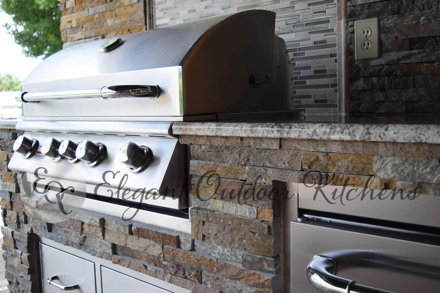 Kitchen Construction Service : Stacked stone galore in whiskey creek custom outdoor