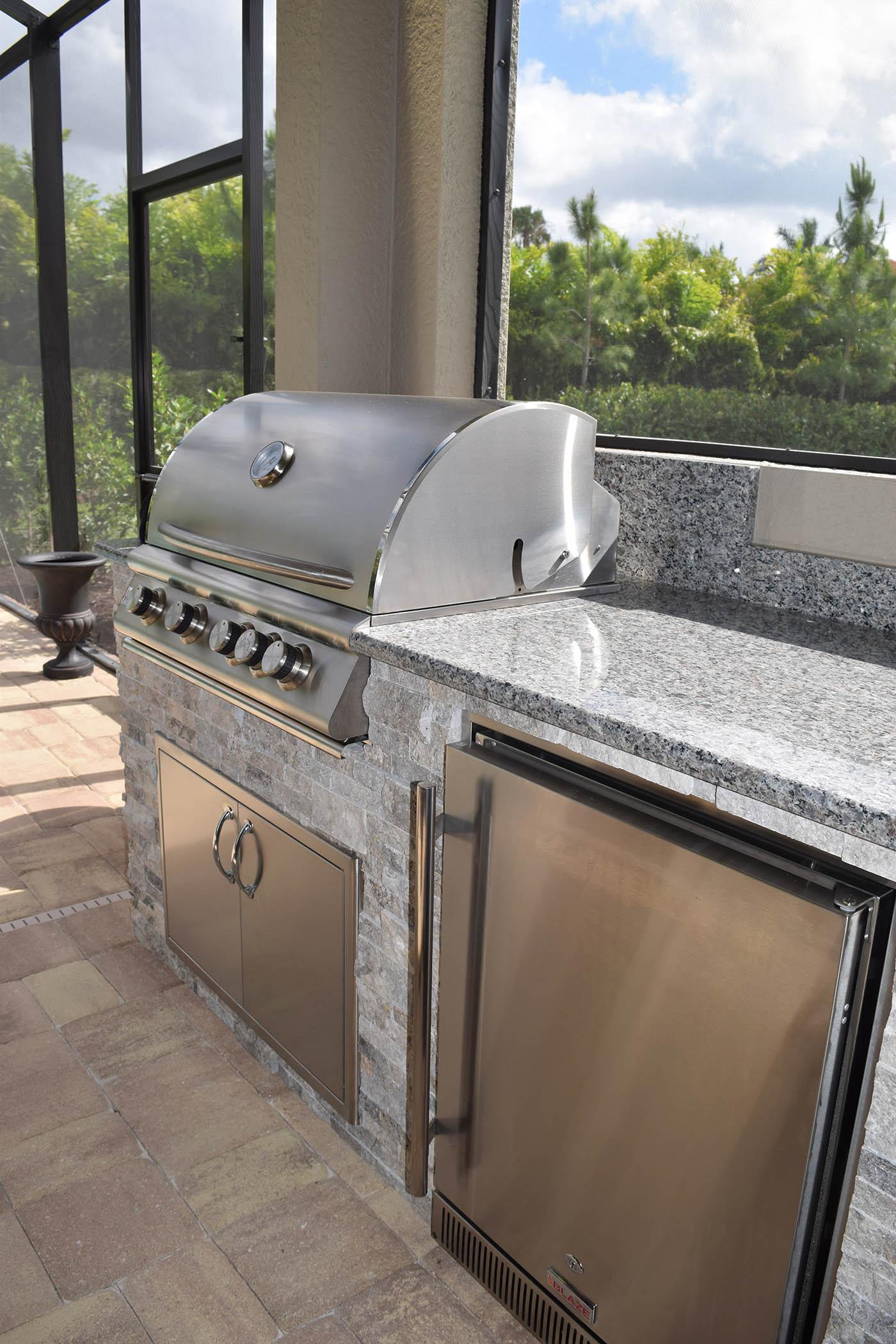 Poolside elegance outdoor kitchen bbq island elegant for Outdoor kitchen grill island