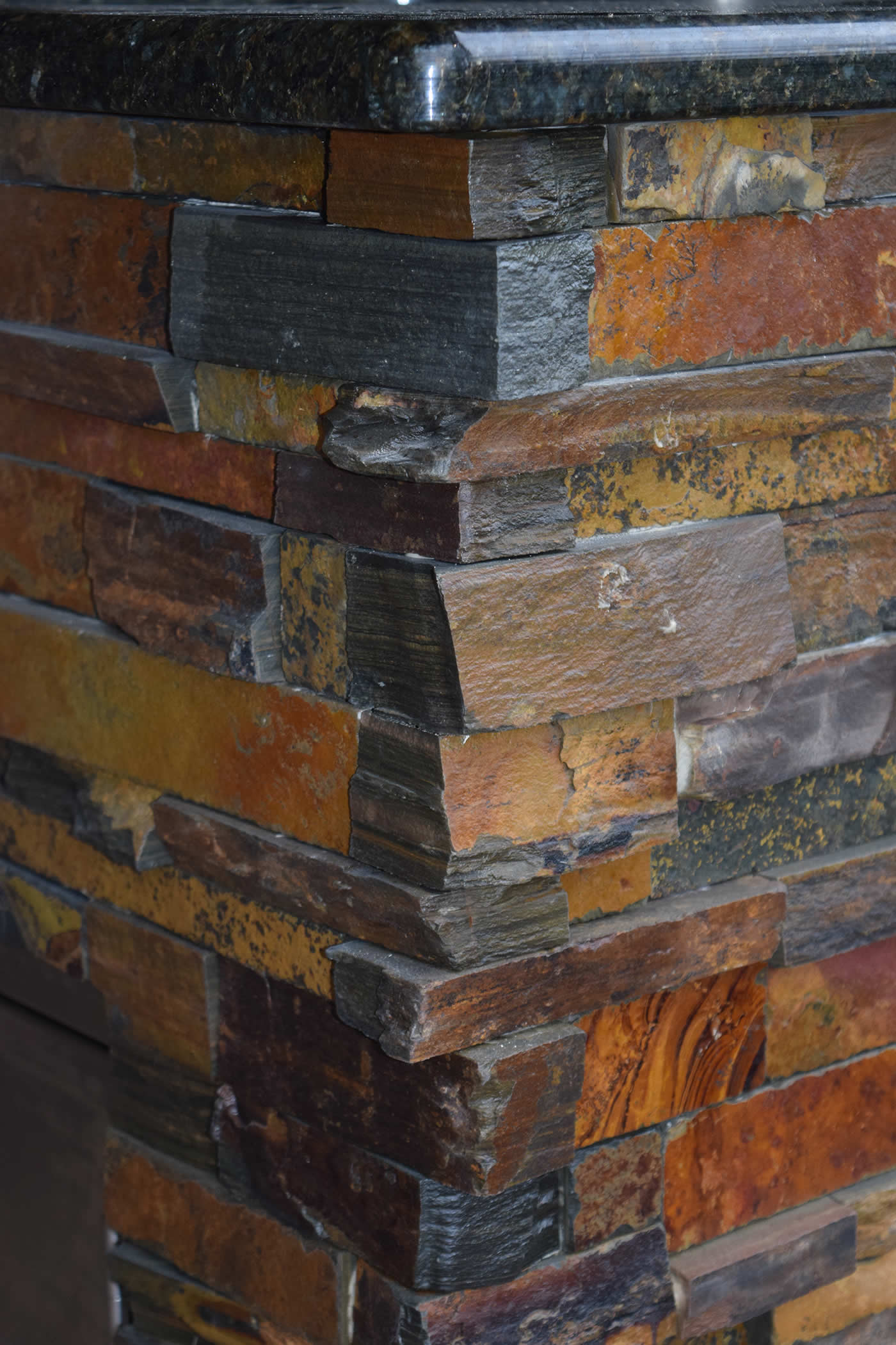 Close-up of California Gold Stacked Stone Fascia - Elegant Outdoor Kitchens of Southwest Florida
