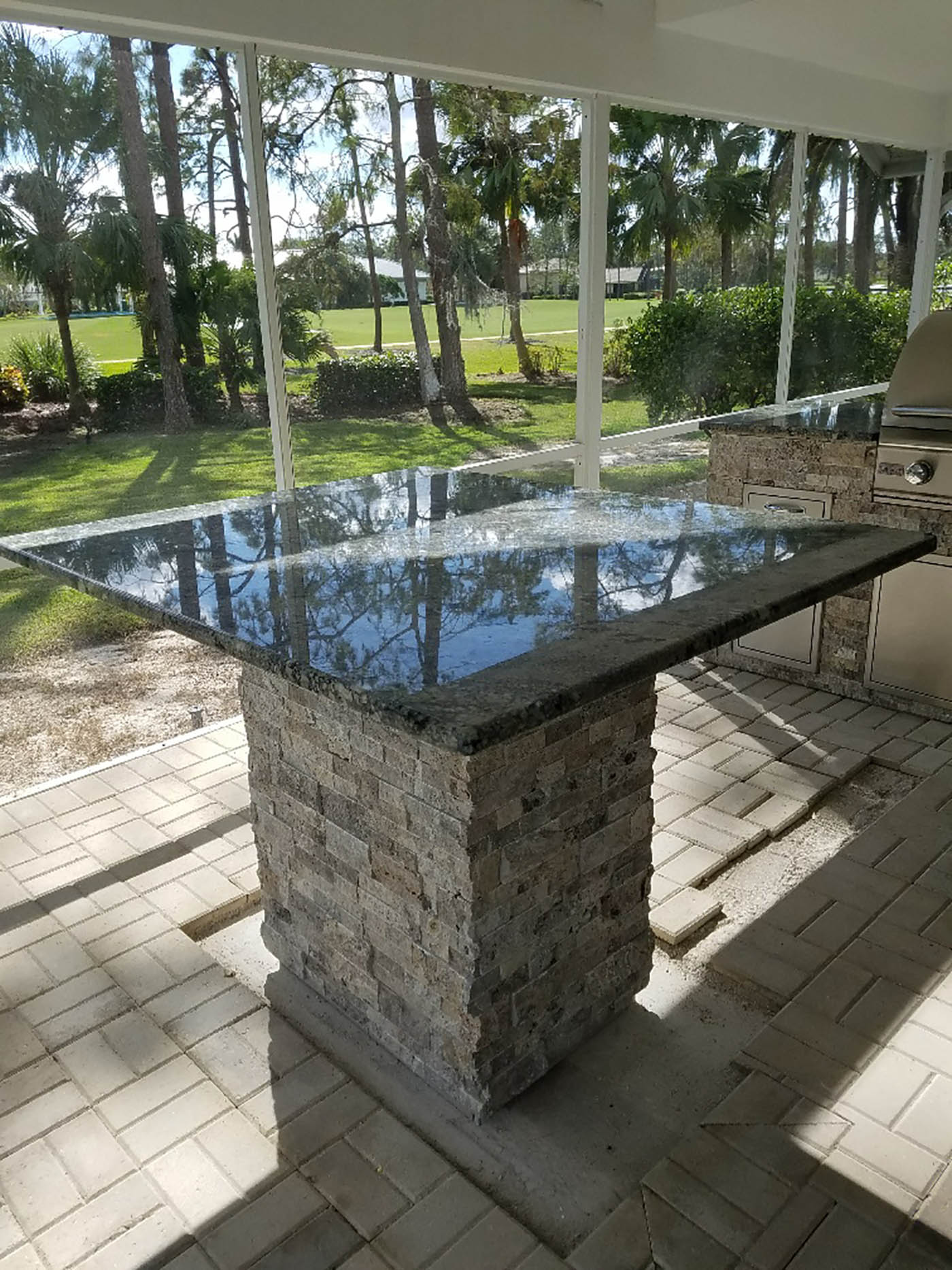 Custom Delirium Granite & Silver Travertine Tabletop Bar Area