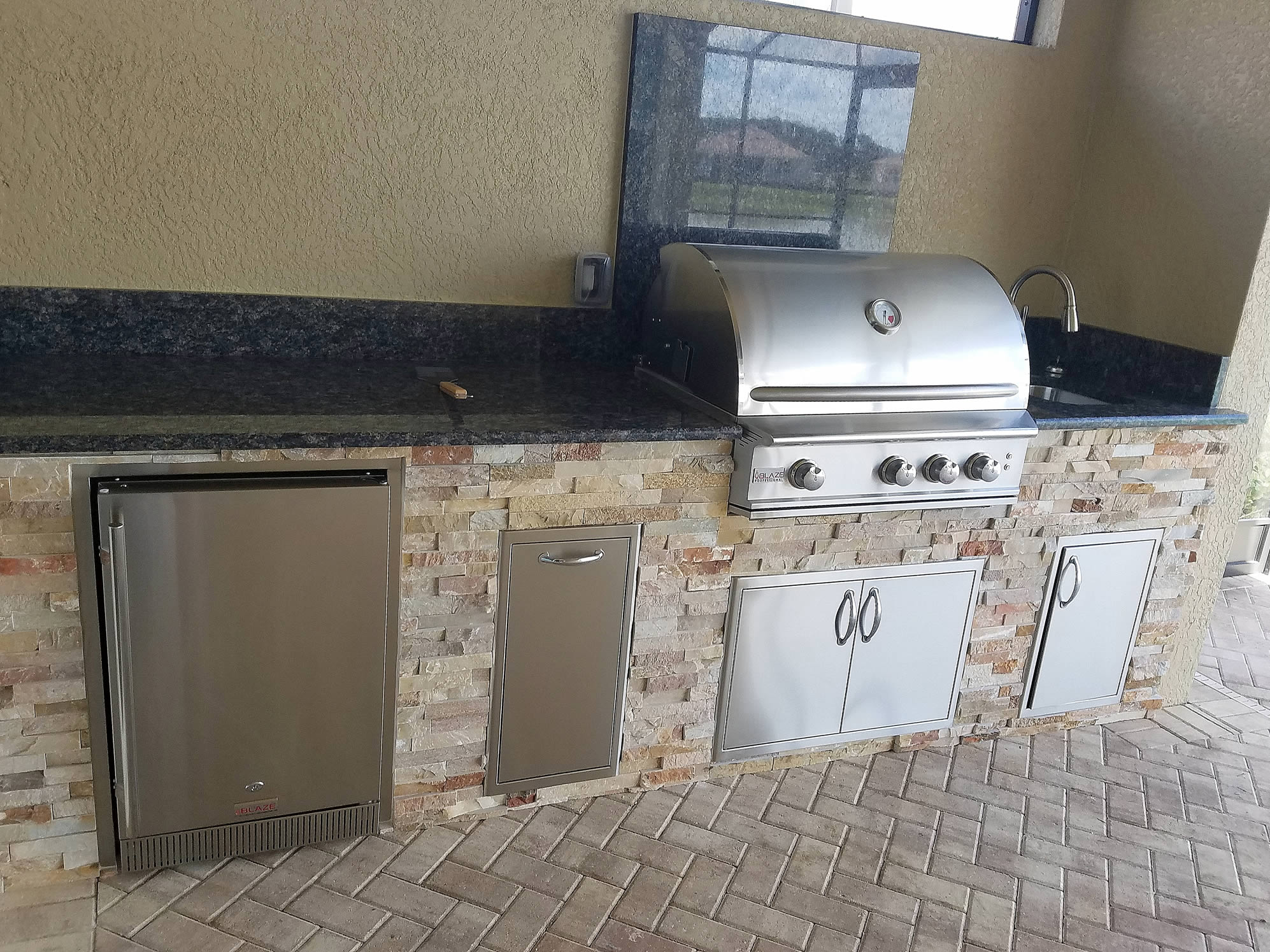 Elegant Outdoor Kitchen With Blue Sapphire Granite And Golden