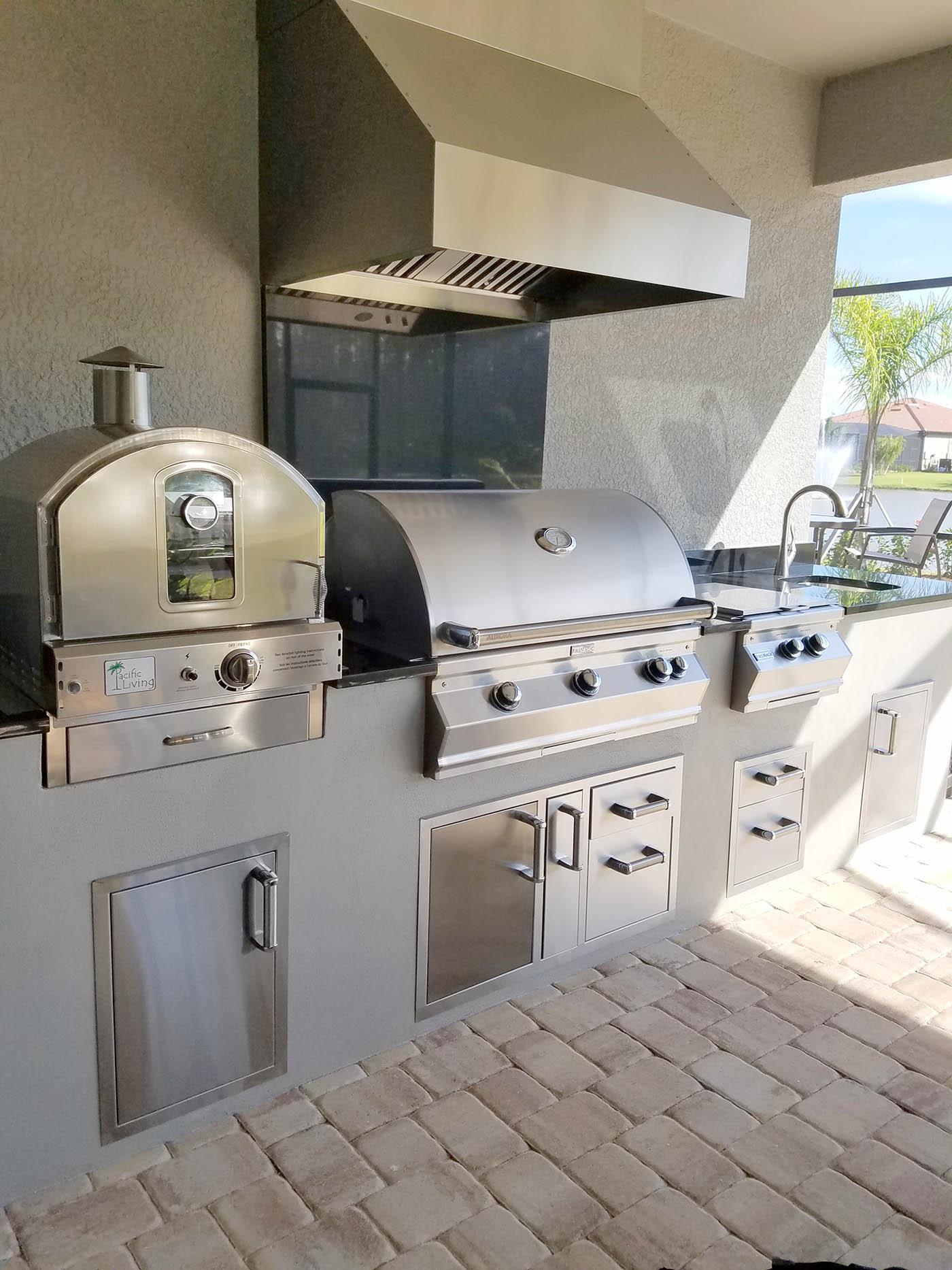 Elegant outdoor kitchens custom barbecue island kitchen for Eldorado stone outdoor kitchen cabinet
