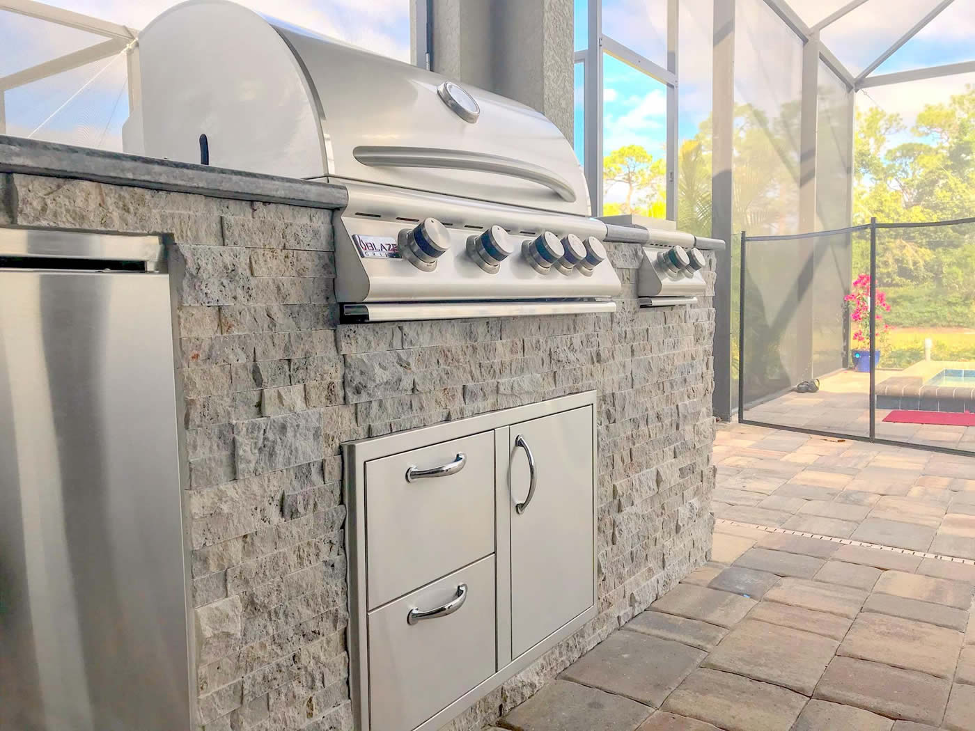 Custom Outdoor Kitchen with Silver Travertine Stacked Stone and Blue Sapphire Granite - Elegant Outdoor Kitchens