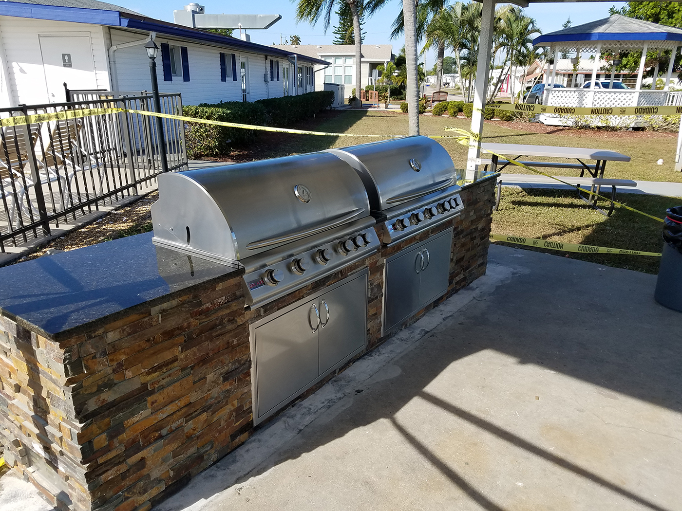 Dueling grills the sequel custom commercial hoa for Outdoor kitchen construction