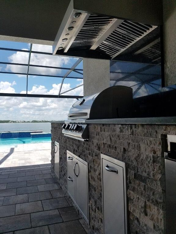 Outdoor Kitchen, Outdoor Kitchens, Elegant, Elegant Outdoor Kitchens, BBQ, BBQ Island, BBQ Islands, Barbecue Islands, Barbecue Island, Custom Outdoor Living, Custom Outdoor Kitchen, Paradise, Florida, Naples, Estero, Ft Myers, Blaze Grills, Blaze Burners, Outdoor Refrigerator, Travertine, Backsplash, vent hood, perfection, beauty